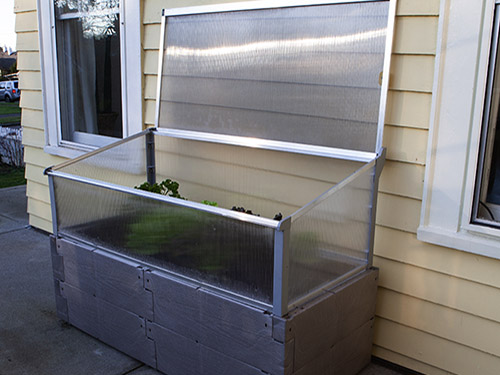 gray timber raised bed against house full open