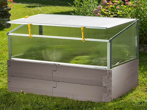 gray timber raised bed with open year round cold frame