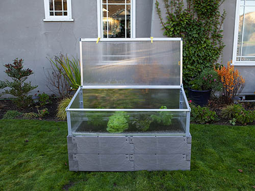 gray timber raised bed with cold frame