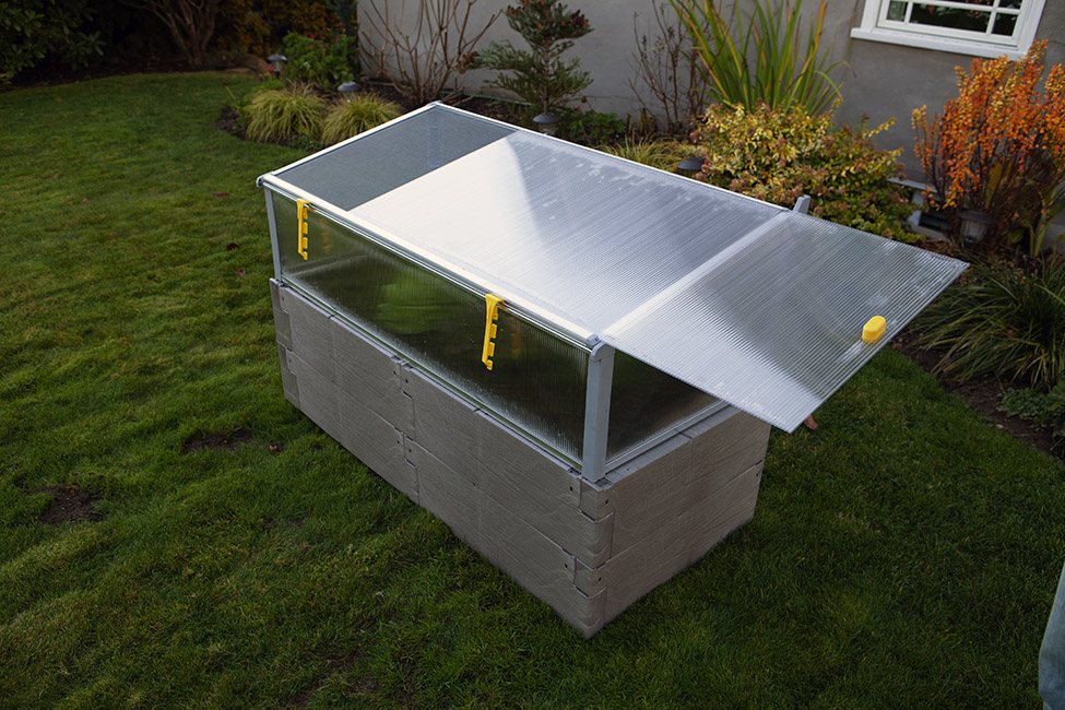 gray timber raised bed with cold frame sliding top panel