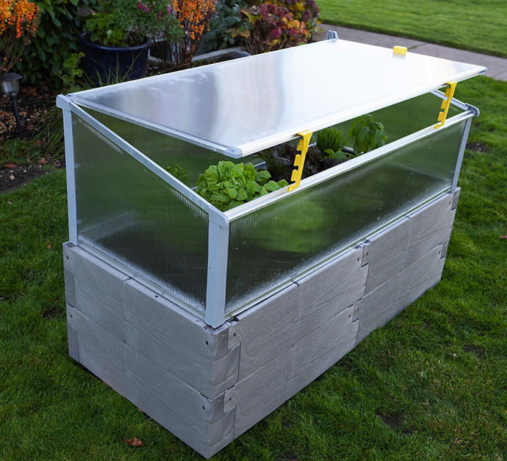 gray timber raised bed with cold frame using openers