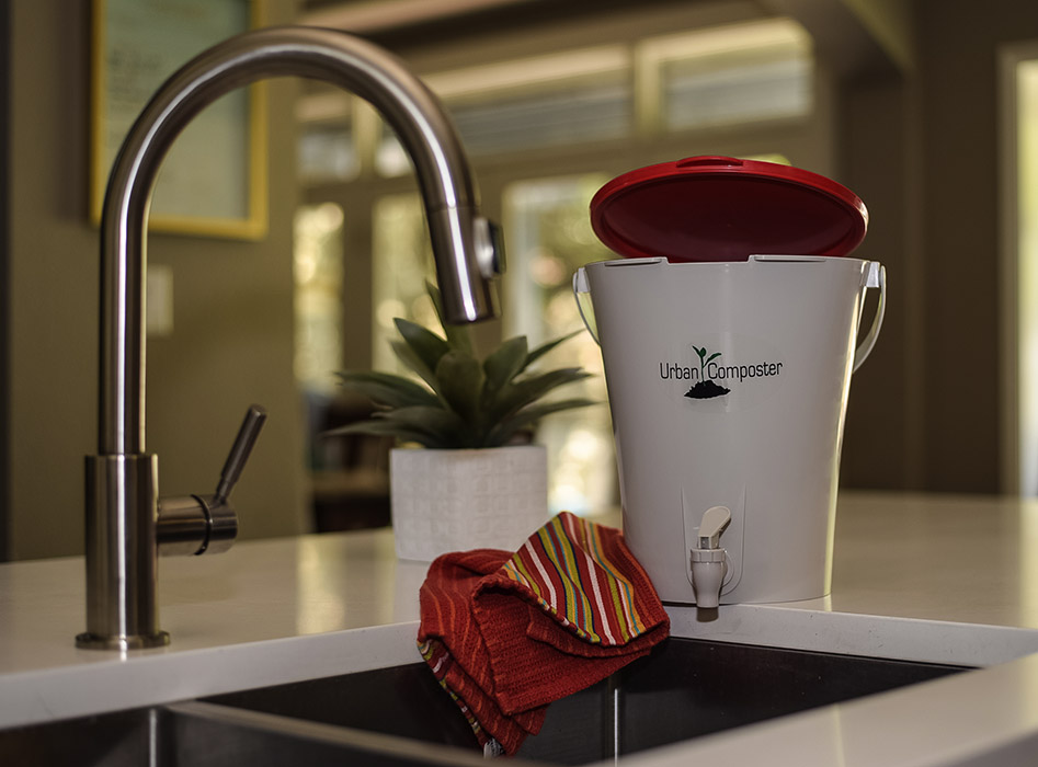 Urban Composter - Small red in kitchen